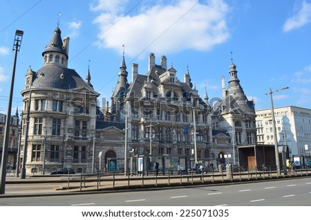 ANTWERP, BELGIUM, MARCH 5,2014: View of traffic in front of the old courthouse in antwerp, belgium. - stock photo