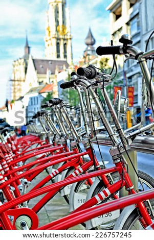 ANTWERP, BELGIUM-OCTOBER 04, 2014: Bicycles for rent from Velo City Bikes in historical center of Antwerp. More than 150 stations are available in the city - stock photo