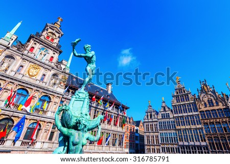 ANTWERP, BELGIUM - SEPTEMBER 02, 2015: bronze statue in front of the city hall in Antwerp. Antwerp is the capital of Antwerp province and with a population of 510,610 the most populous city in Belgium - stock photo