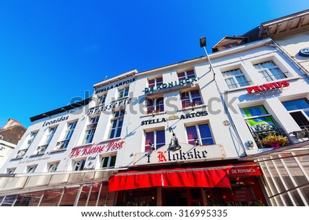 ANTWERP, BELGIUM - SEPTEMBER 03, 2015: buildings of restaurants with beer names in the old town of Antwerp. Antwerp is the capital of Antwerp province and with 510610 most populous city in Belgium