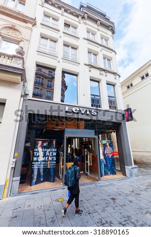 ANTWERP, BELGIUM - SEPTEMBER 03, 2015: Levis store with unidentified people in Antwerp. Its an American clothing company known worldwide for its Levis brand of denim jeans. It was founded in 1853