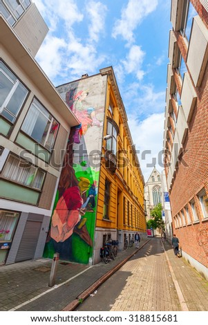 ANTWERP, BELGIUM - SEPTEMBER 03, 2015: wall art in the city of Antwerp with unidentified people. Antwerp is capital of Antwerp province and with population of 510,610 the most populous city in Belgium - stock photo