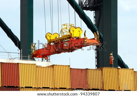 Antwerp port with containers to be shipped worldwide  - all logos and brand names removed - stock photo