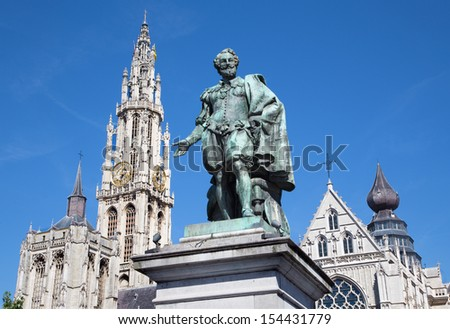 Antwerp - Statue of painter P. P. Rubens and tower of cathedral by Willem Geefs (1805-1883)