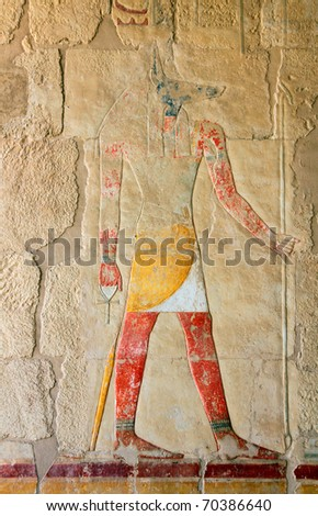 anubis - ancient egypt color image on wall in luxor - stock photo
