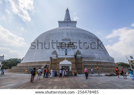 ANURADHAPURA, SRI LANKA - JAN 11, 2015: The Ruwanwelisaya is a stupa in Sri Lanka, considered a marvel for its architectural qualities and sacred to many Buddhists all over the world. - stock photo