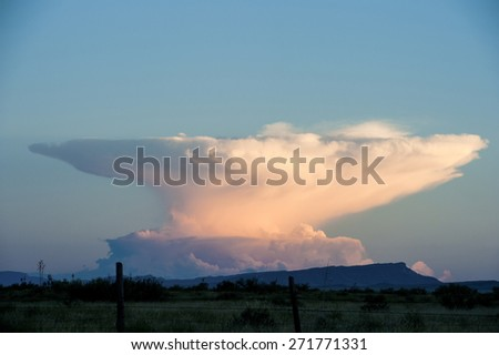 Anvil Cloud Thunderstorm in the distance - stock photo