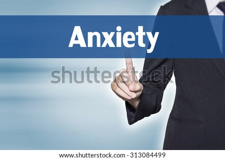 Anxiety Business woman pointing at word for business background concept - stock photo