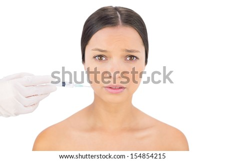 Anxious bare model having injection around mouth on white background - stock photo
