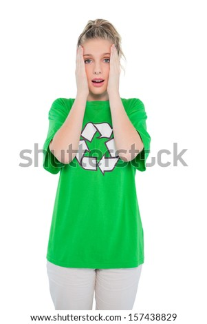 Anxious blonde activist wearing recycling tshirt posing on white background - stock photo