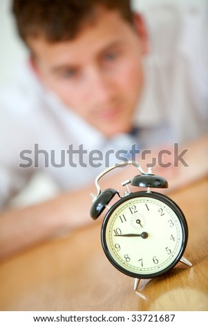 anxious blurry business man starring at the clock