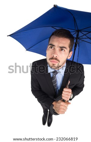 Anxious businessman under umbrella looking up on white background - stock photo