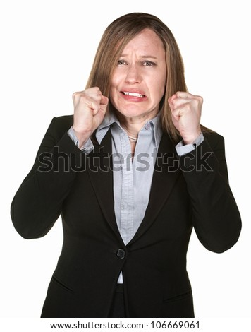 Anxious Caucasian business woman with clenched fists - stock photo
