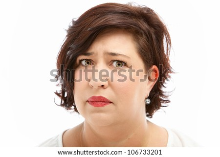 Anxious worried middle-aged woman with upset expression isolated on white - stock photo