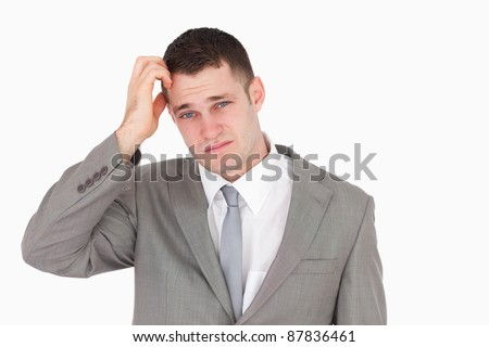 Anxious young businessman against a white background - stock photo