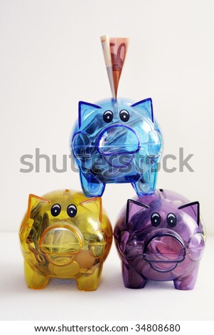 any colored piggy banks of the childs - stock photo