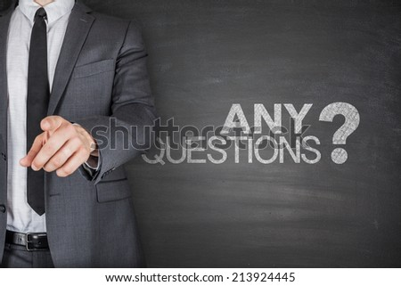 Any Questions concept on black Blackboard with businessman - stock photo