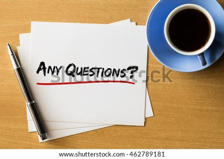 Any questions? - handwriting on papers with cup of coffee and pen, business concept