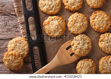 Anzac biscuits close up in baking dish on the table. horizontal view from above
