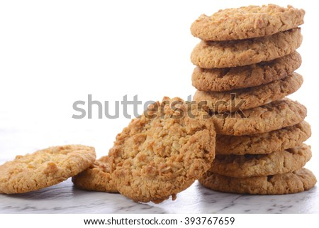 ANZAC Day, April 25, traditional Anzac biscuits on white marble table.  - stock photo