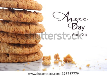 ANZAC Day, April 25, traditional Anzac biscuits on white marble table closeup with copy space. - stock photo