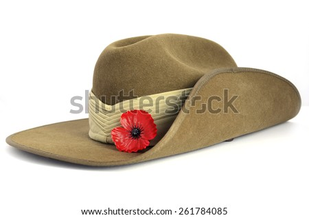 Anzac Day army slouch hat with red poppy on white background.  - stock photo