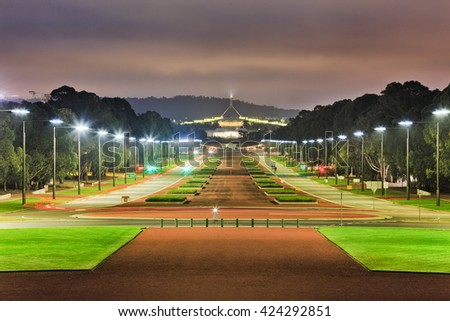 ANZAC parade wide road and street with bright illumination by light poles at sunrise in Canberra, Australia capital city. - stock photo