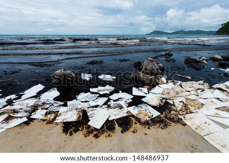 Ao Prao Beach was full of crude oil and absorb paper on oil spill accident on Ao Prao Beach at Samet island on July 31,2013 in Rayong,Thailand