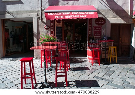 Aosta, Italy: the red tables and chairs of a restaurant in the center of the city on July 29, 2016. Aosta is the capital of the autonomous region of the Aosta Valley, in the northwest of Italy
