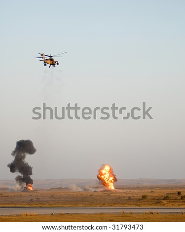 Apache helicopter shooting at targets - stock photo