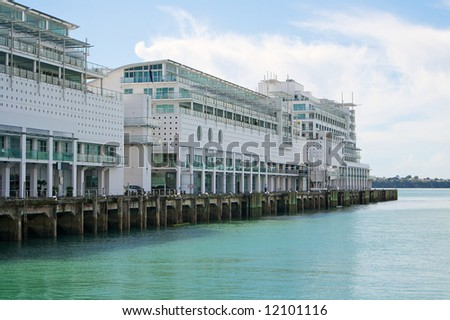 Apartment block floating on water - stock photo