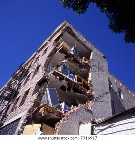Apartment building after an earthquake - stock photo