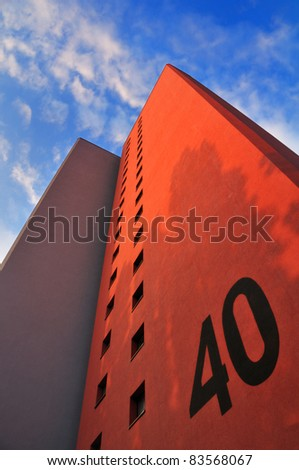 apartment building against blue sky - stock photo