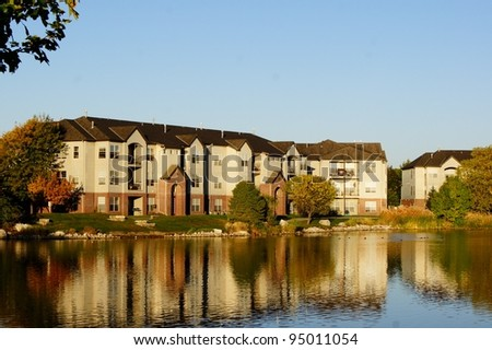 Apartment building complex on the lake - stock photo