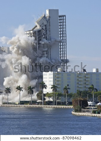apartment building demolition using blast of dynamite