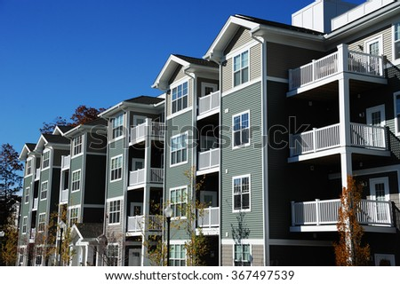apartment building in sunny day - stock photo