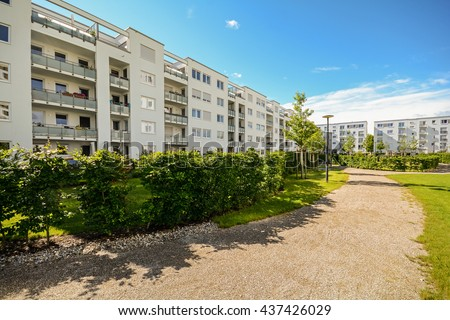 Apartment building in the city - Facade of new modern residential houses with low energy standard - stock photo