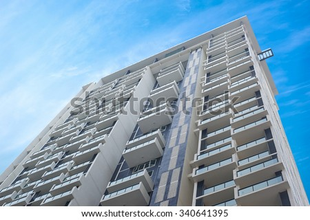 Apartment building.Multistoried modern and stylish living block of flats. Real estate. New house.Real Estate. - stock photo
