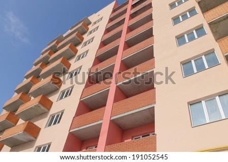 Apartment building on a blue sky - stock photo