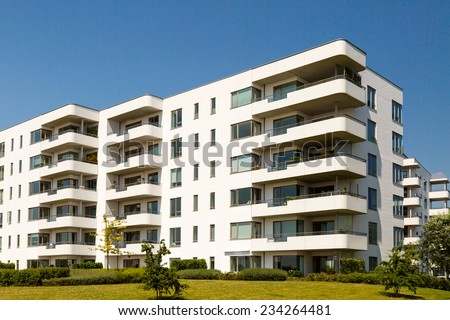Apartment building on a sunny summer day in Hellerup, a suburb of Copenhagen, Denmark. - stock photo