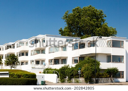 Apartment building on a sunny summer day in Klampenborg, a suburb of Copenhagen, Denmark. - stock photo