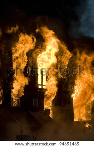 Apartment Building On Fire Night Time Stock Photo