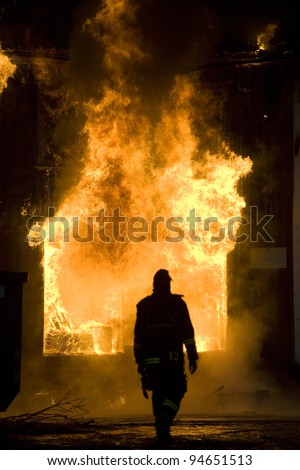 Apartment building on Fire at Night time - stock photo