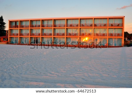 Apartment building on the beach in front of the Gulf Coast sea, in St. Petersburg, Florida - stock photo