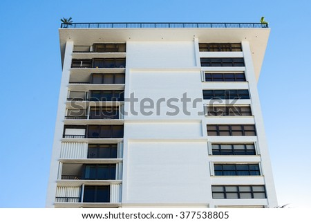 Apartment building with a roof terrace - stock photo