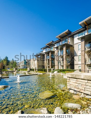 apartment building with outdoor pond in Vancouver, Canada. Residential architecture - stock photo