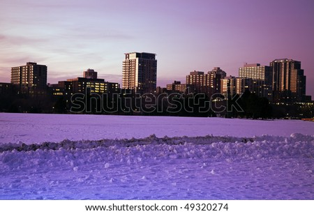 Apartment buildings along Lake Michigan in Milwaukee, Wisconsin. Sunset time. - stock photo