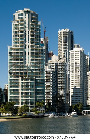 Apartment buildings beside a waterway, Surfers Paradise, Queensland, Australia - stock photo