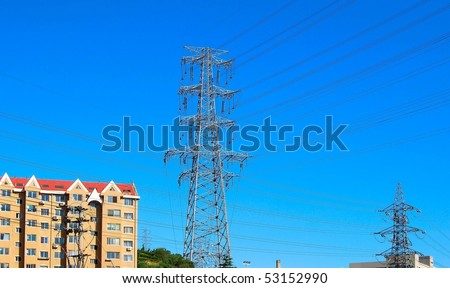 Apartment buildings. Group of electricity pylons. Dalian, China.
