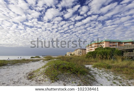 Apartment by the Sea Apartment building facing the ocean on a beach in Florida. - stock photo